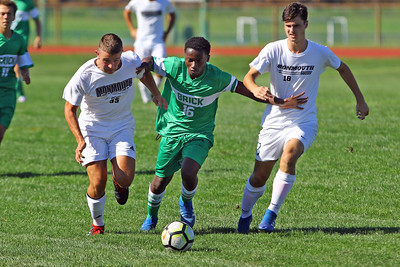 Emanuel Vl (center) from Brick battles with defenders as Brick Township High School takes on Monmouth Regional High School in a boys varsity soccer game in Brick on Tuesday August 3, 2019.  (MARK R. SULLIVAN THE OCEAN STAR)