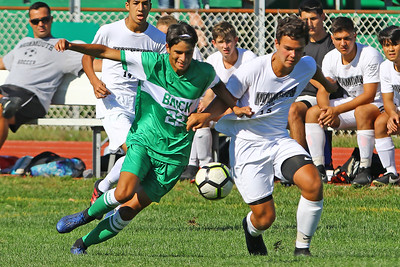 Danny Buenano (left) from Brick battles with Tom Siracusa (right) as Brick Township High School takes on Monmouth Regional High School in a boys varsity soccer game in Brick on Tuesday August 3, 2019.  (MARK R. SULLIVAN THE OCEAN STAR)