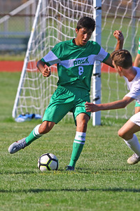 Christian Alino (left) from Brick gets his foot on the ball as Brick Township High School takes on Monmouth Regional High School in a boys varsity soccer game in Brick on Tuesday August 3, 2019.  (MARK R. SULLIVAN THE OCEAN STAR)