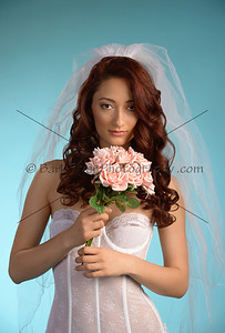 We add silk flowers to your Bride Boudoir session to give it a high fashion look.