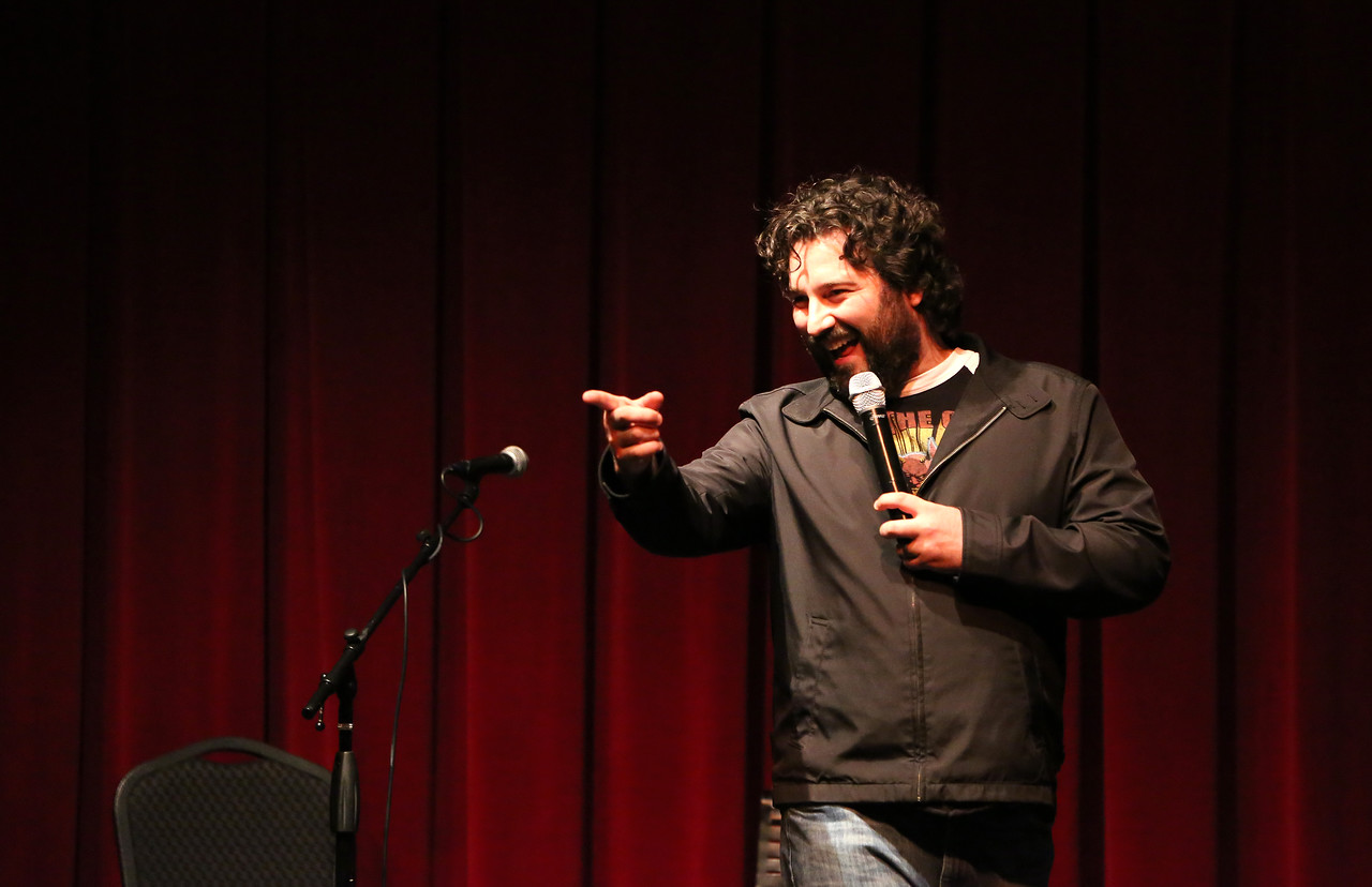 New York based comedian Mark Riccadonna introduced the night's talent and told a few jokes of his own. <br /> Photo by John Fitts