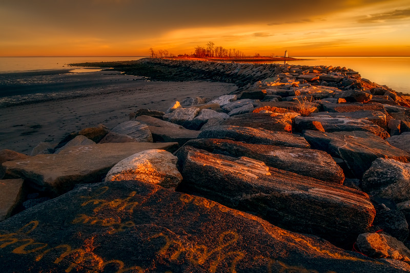 Sunset by the Breakwater at Seaside Park in Bridgeport, Connecticut, USA.