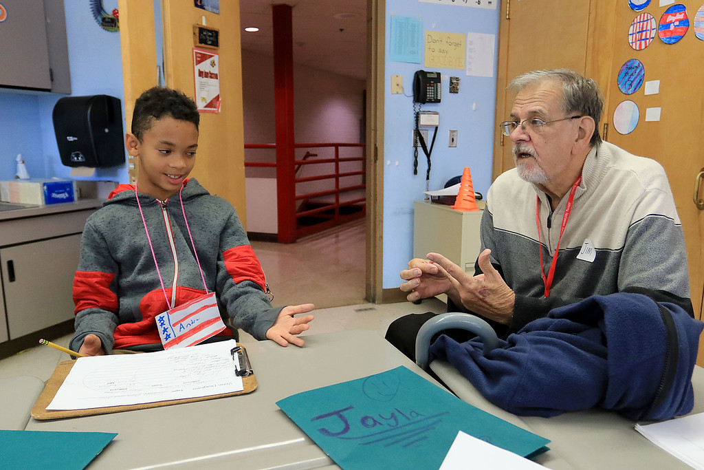 . Johnny Appleseed Elementary School in Leominster participated in the Bridges Together Program, an international program that puts seniors in elementary school classrooms to hang out with the kids and teach them things about the past. Jim Couture chat with Andre Jones, 9, during his visit. SENTINEL & ENTERPRISE/JOHN LOVE