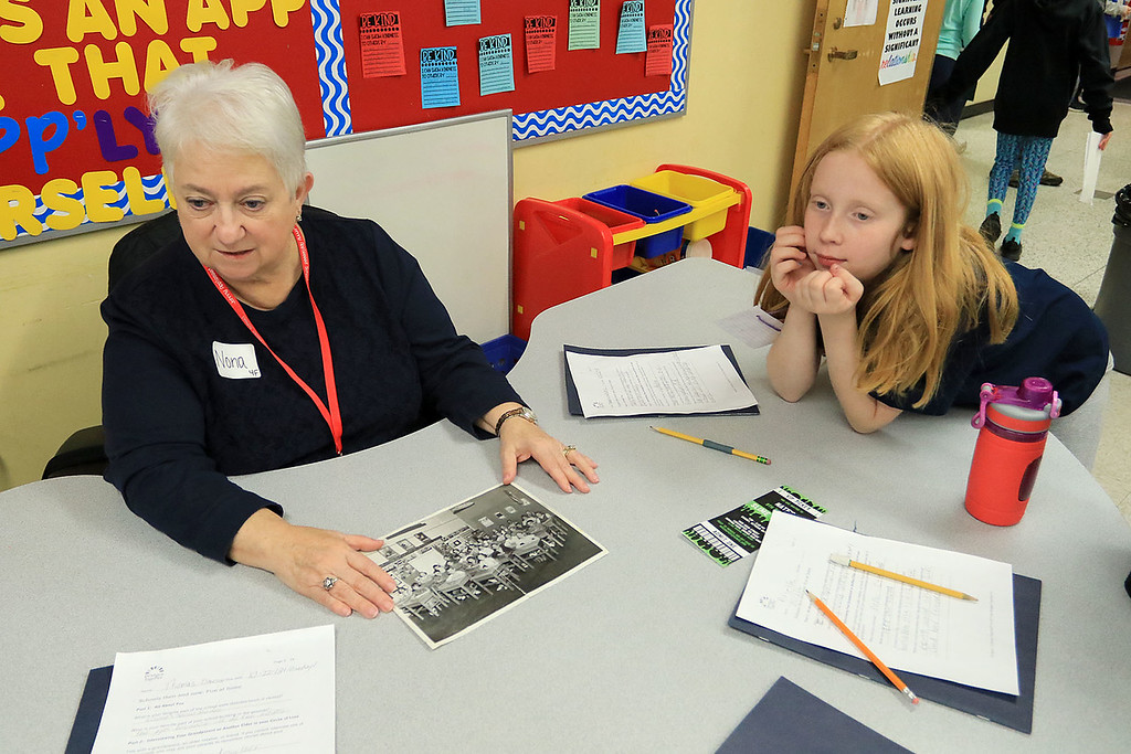 . Johnny Appleseed Elementary School in Leominster participated in the Bridges Together Program, an international program that puts seniors in elementary school classrooms to hang out with the kids and teach them things about the past. Madeline Weeks, 9, listens to Nona Ojala during the program. SENTINEL & ENTERPRISE/JOHN LOVE