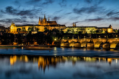 Night view of Charles Bridge and Lobkowicz Palace, Prague, Czech Republic.