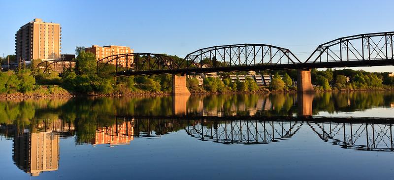 Bridge relecting in calm River
