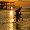 Cycling past the West Pier