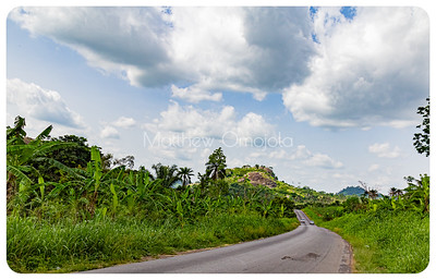 Disappearing Highway with a mountain range in the distance on Iyin Ado Ekiti road Ekiti State of Nigeria.