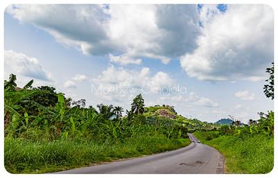 Disappearing Highway with a mountain range in the distance on Iyin Ado Ekiti road Ekiti State of Nigeria.