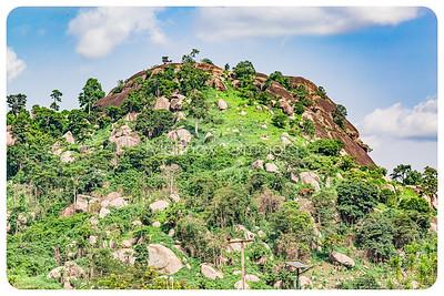 Domed rock with many boulders along Iyin Ado Ekiti  road