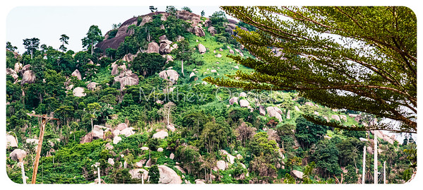 Close up of the top of a mountain in Ekiti State. This mountain is the highest point along a ridge on the Iyin Ado Ekiti road. It has many boulders surrounding it.