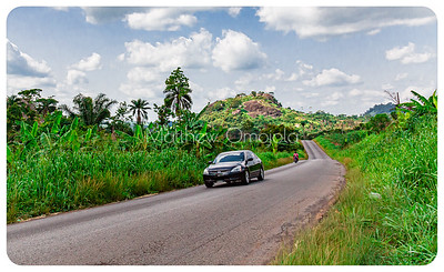 Disappearing road! A stretch of the main road between Ado Ekiti and Iyin Ekiti obstructed by a ridge. The road disappears into a deep and subsequently winds around the ridge to get to its destination.
