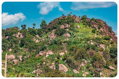 Ekiti hills. Many boulders with green foliage