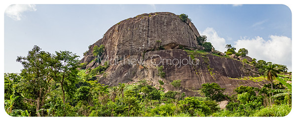 Two huge rocks set upon each other with smaller boulders along Ado Ekiti Iyin road.