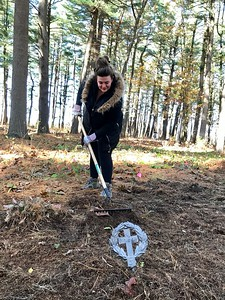 Mary Lohan of Lynnfield cleared the ground around some graves. Photo by Mary Leach