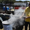Lion Vince shoveling the hot coals into the water that the corn had been soaked in; can't be driving up the Interstate through those dry grasslands with hot embers blowing out of the rig behind him!