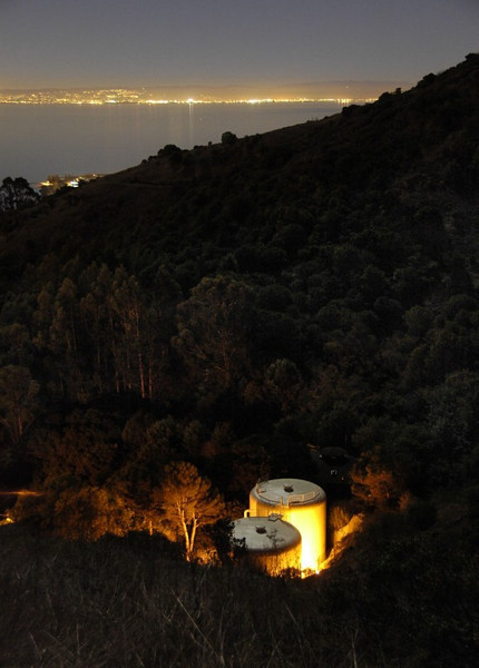Nestled in a canyon below, lights blazing away, a pair of smaller tanks silently maintain their reserves of that precious commodity we so often take for granted. In the distance is a seemingly limitless supply of water, but not a drop of it is drinkable.