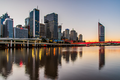 View of Brisbane City skyline at sunrise.