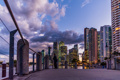 View of Brisbane City skyline from City Reach Boardwalk at dusk.