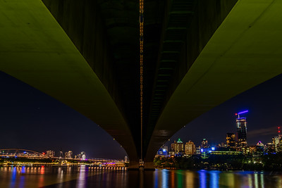 View of South Bank and Brisbane CBD skyline from under the Captain Cook Bridge and Riverside Expressway.