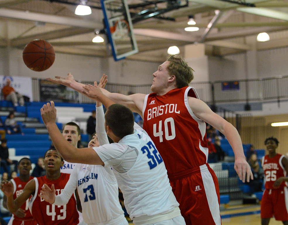 . Kevin Farrell (40) reaches for rebound over Kris Shields (32 and Nick Fossile (33).
