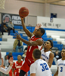 Alex Jerbo (1) soars to the basket.