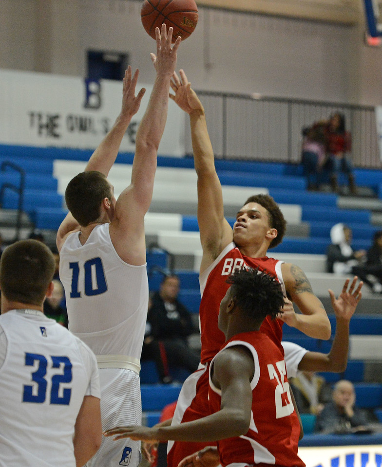 Dayeshawn Cortez (3) shoots over James Leible (10).