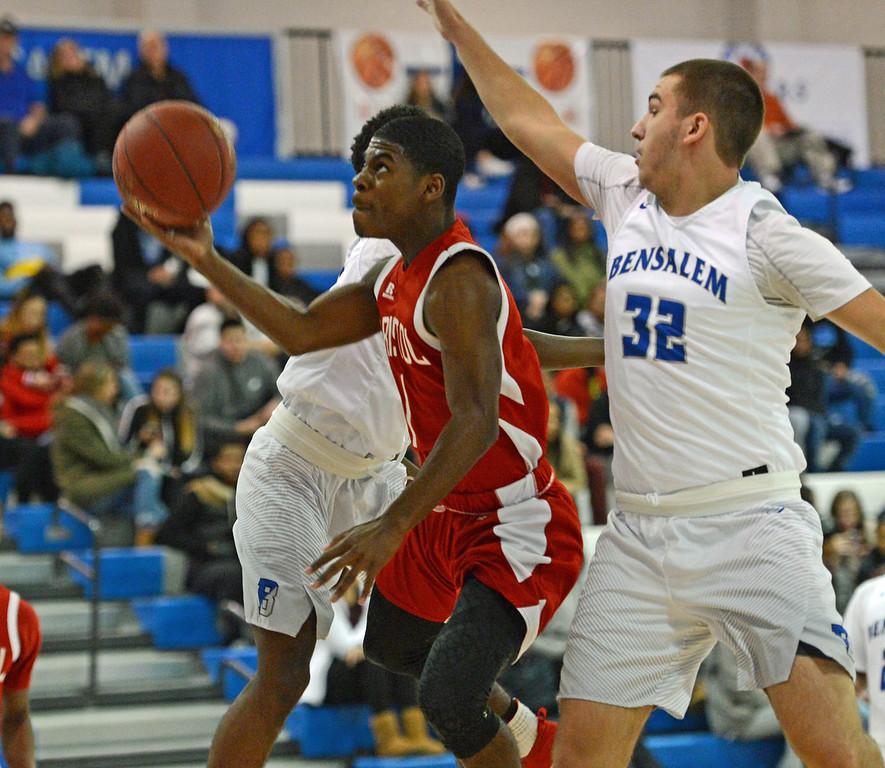 . Alex Jerbo (1) heads for the hoop.