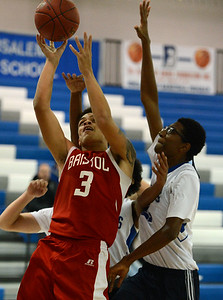 Dayeshawn Cortez (3) drives by Hemidou Doumbie (21).