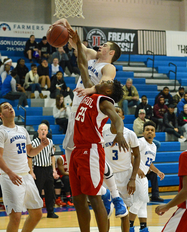 . Aaron Clark (25) battles James Leible (10) for rebound.