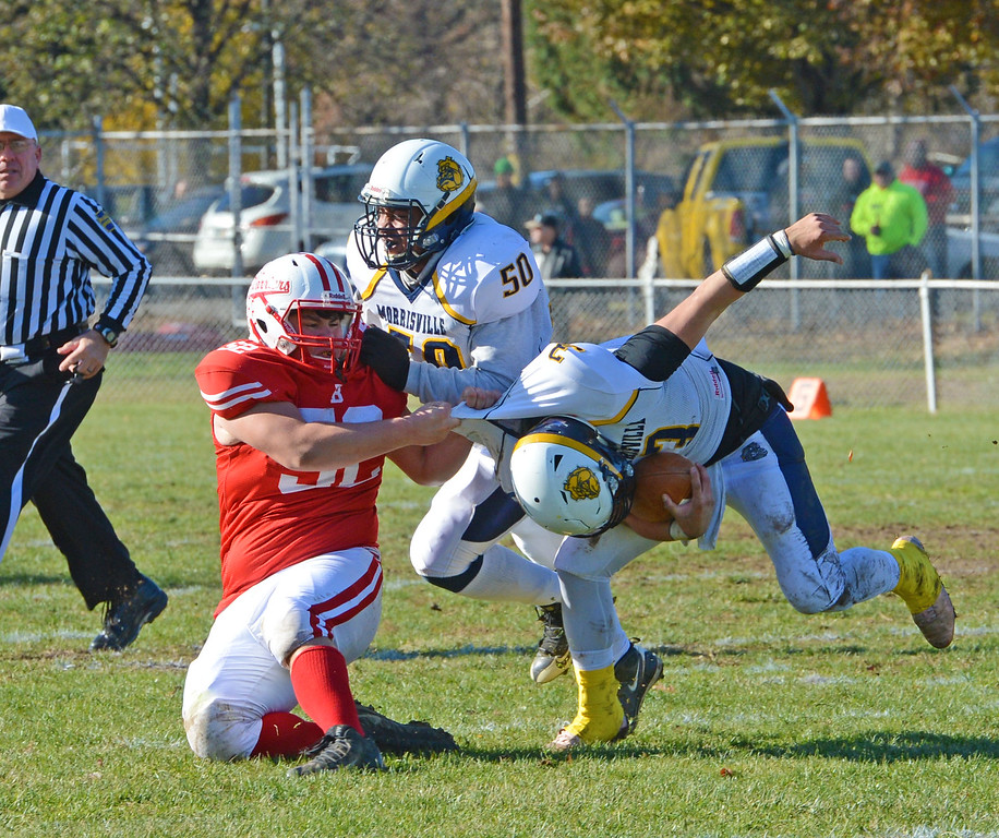 . Bristol senior Danny Collins (52) drags Felix Feliciano (3) to the ground.