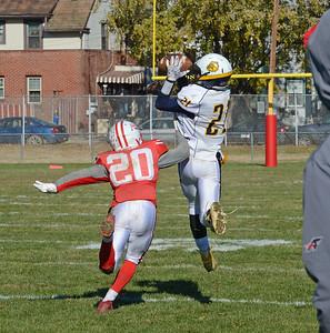 Mekhi Crooks (21) hauls in 61 yard aerial.
