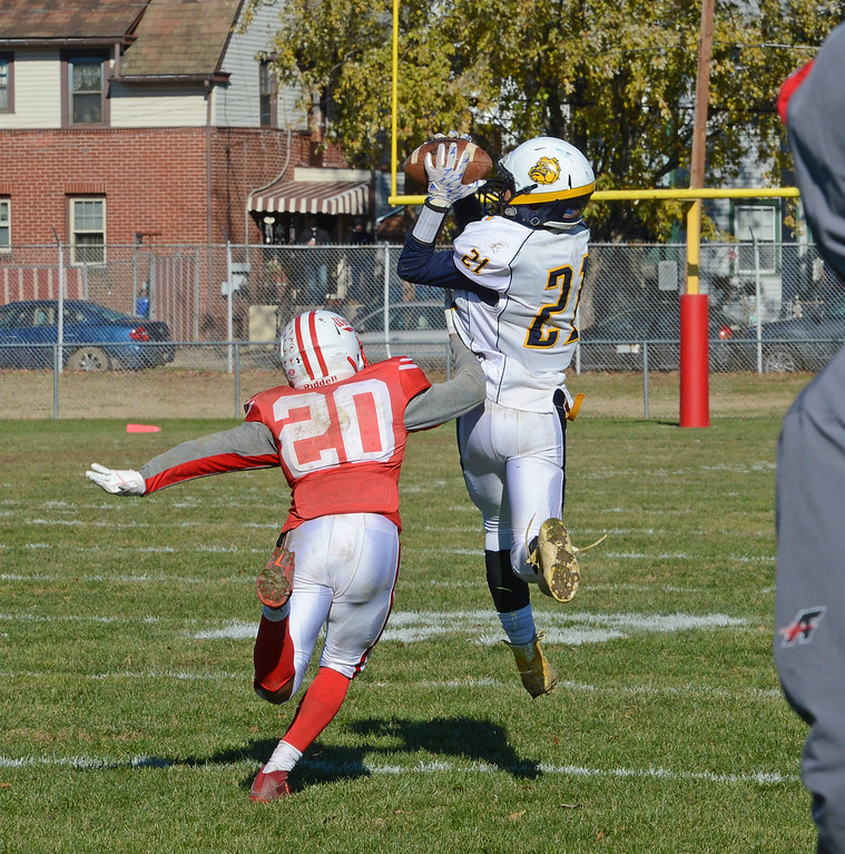 . Mekhi Crooks (21) hauls in 61 yard aerial.