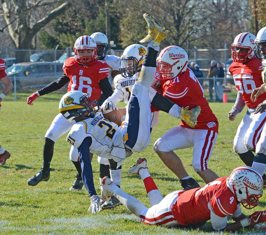 . Mekhi Crooks (21) is upended by Bristol defense.