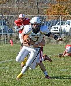 Morrisville quarterback Felix Feliciano (3) tries to break tackle.