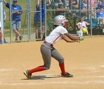 Tiana Nelson (1) gets bunt single.