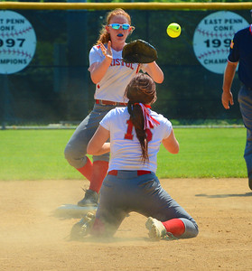 Cara Fabiano (16) flips ball to Rachel Freas (22) to get force at second base.