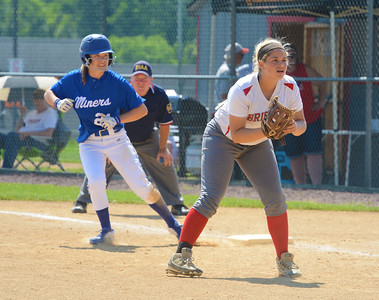 Kacie Pinelli (28) waits at first as Emily Graeff (21) leads off.