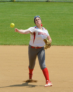 Hailey Sweeney (27) fires the ball across the diamond.