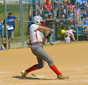 Tianna Brewington (11) rips into a pitch.