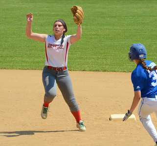 Shortstop Cara Fabiano (16) goes up for high throw.