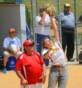 Tianna Brewington (11) goes high for throw during warmup.
