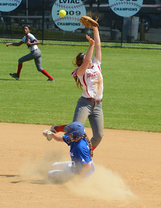 Cara Fabiani (16) tries to nail Maggie Wigoda (33) at second base.