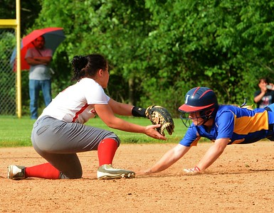 Bristol junior Tianna Brewington (#11), left, gets set to apply tag to Kelsey Stemler (10).