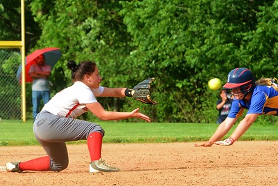 Bristol junior Tianna Brewington (#11), left, awaits ball and a sliding Kelsey Stemler (10), for Greenwood.