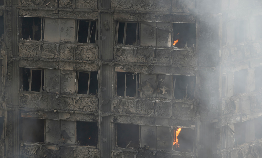 . A view of a high rise apartment block on fire, in London, Wednesday, June 14, 2017. Firefighters are battling a huge blaze at a west London high-rise block that houses more than 100 apartments. (AP Photo/Alastair Grant)