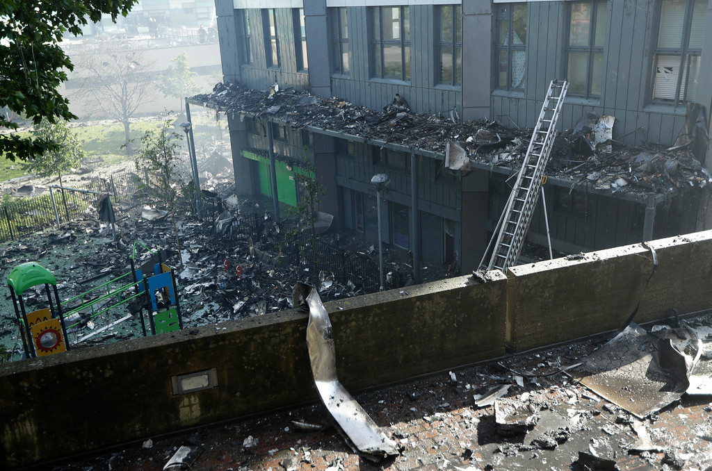 . Charred debris is strewn across the floor after a massive fire raged in a 27-floor high-rise apartment building in London, Wednesday, June 14, 2017. Fire swept through a high-rise apartment building in west London early Wednesday, killing an unknown number of people and sending more than 50 people to area hospitals. (AP Photo/Matt Dunham)