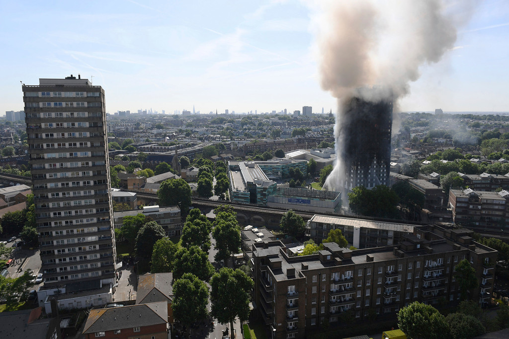 . Smoke billows from a fire that has engulfed the 24-storey Grenfell Tower in west London, Wednesday June 14, 2017. Fire swept through a high-rise apartment building in west London early Wednesday, killing an unknown number of people with around 50 people being taken to hospital. (Victoria Jones/PA via AP)