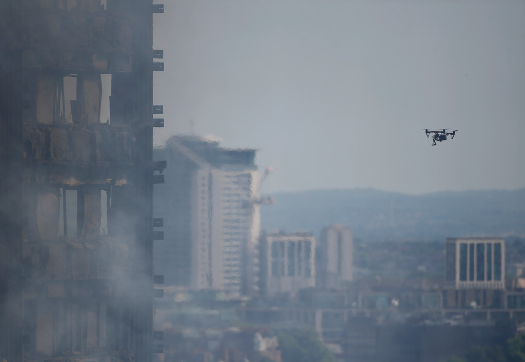 . A drone launched by the emergency services looks at the damage created by fire to a high rise apartment block in London, Wednesday, June 14, 2017.  Police confirmed Wednesday that six people died but they expect to toll to rise after a complex recovery operation that will last days. (AP Photo/Alastair Grant)