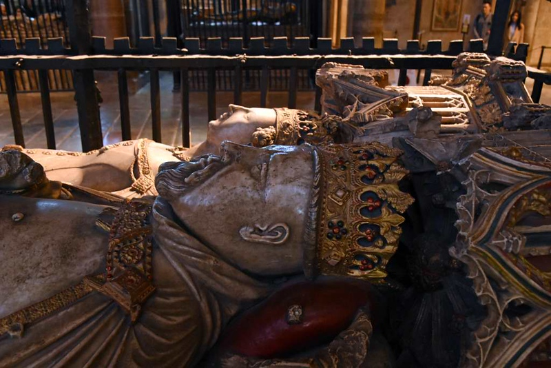 """Tomb of King Henry IV (1367 - 1413) and his wife Joan of Navarre, Canterbury Cathedral, 10 May 2017.  Henry chose to be buried at Canterbury, and is the only king buried here.  His tomb is opposite that of the Black Prince, his uncle.   Henry became king in 1399 when he seized the throne from King Richard II, the Black Prince's son and his cousin.  It was of Henry's worries after the usurpation that Shakespeare wrote """"Uneasy lies the head that wears the crown..."""""""